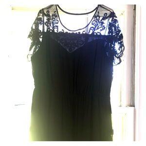 Knee length ASOS black dress.